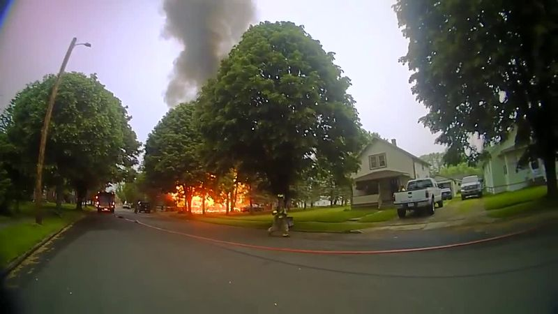 New body camera video shows police officers responding to Brewster house fire
