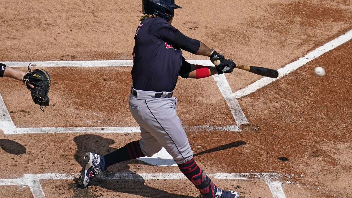 Cleveland Indians' Jose Ramirez hits a double during the first inning of a baseball game...