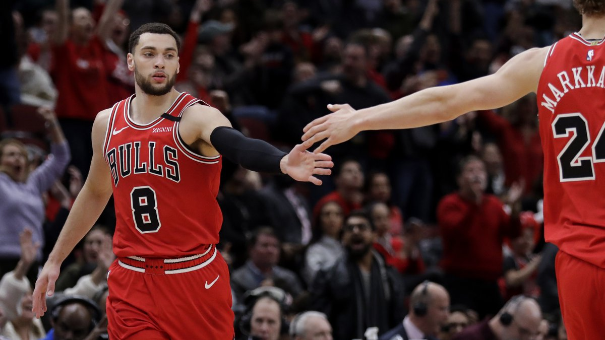 Chicago Bulls guard Zach LaVine, left, celebrates with forward Lauri Markkanen after scoring a...