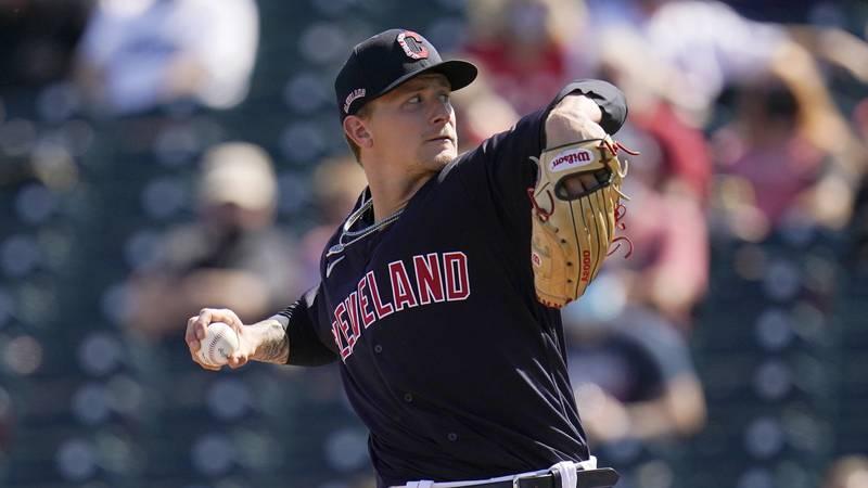 Cleveland Indians starting pitcher Zach Plesac throws a pitch against the Arizona Diamondbacks...