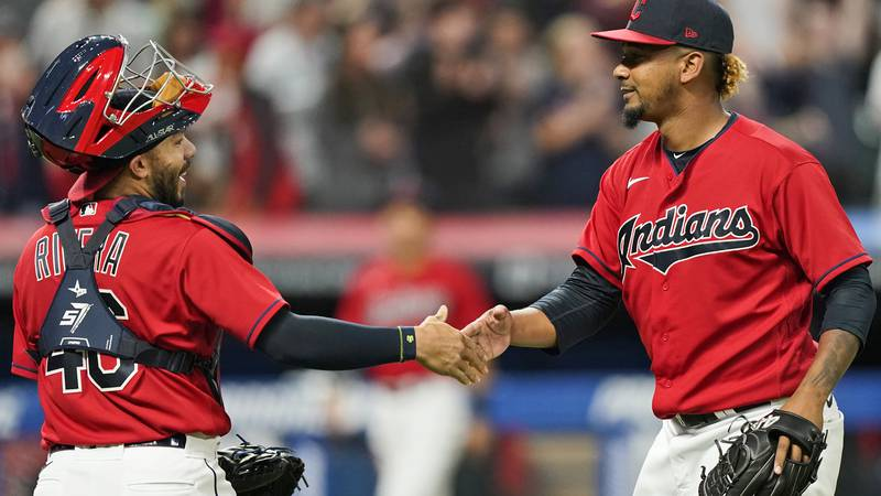 Cleveland Indians relief pitcher Emmanuel Clase, right, is congratulated by catcher Rene Rivera...