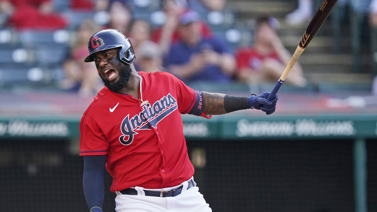 Cleveland Indians' Franmil Reyes reacts after swinging in the sixth inning of a baseball game...