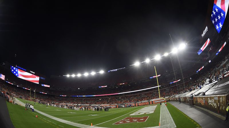 The Cleveland Browns and the Cincinnati Bengals stand for the National Anthem before an NFL...