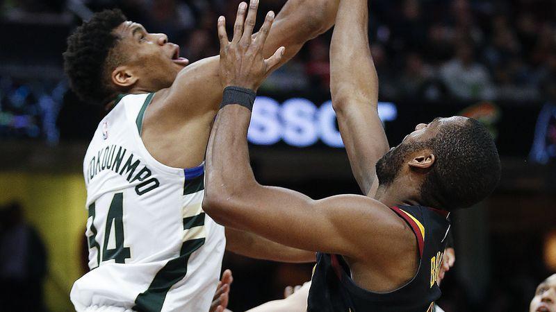 Milwaukee Bucks' Giannis Antetokounmpo (34), from Greece, blocks a shot by Cleveland Cavaliers'...