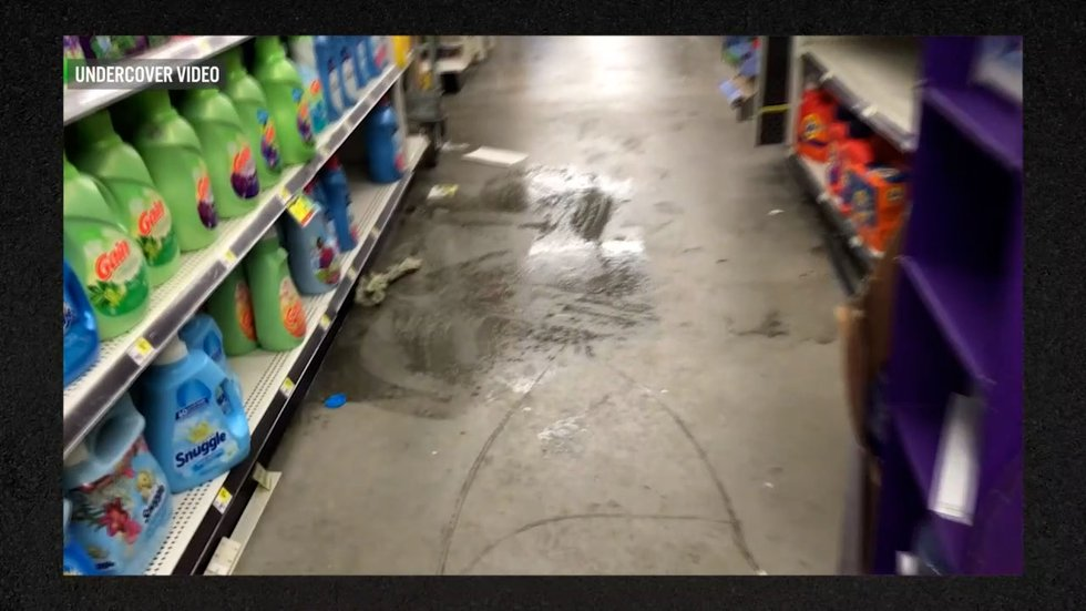 A wet floor with no signs around it at the Dollar General on E. 157th St. & St. Clair.