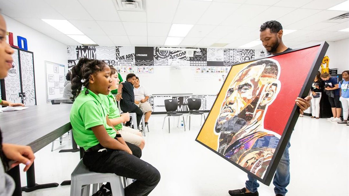 Professional artist Kris Rhymes gifted the I PROMISE SCHOOL with a one-of-a-kind piece of...
