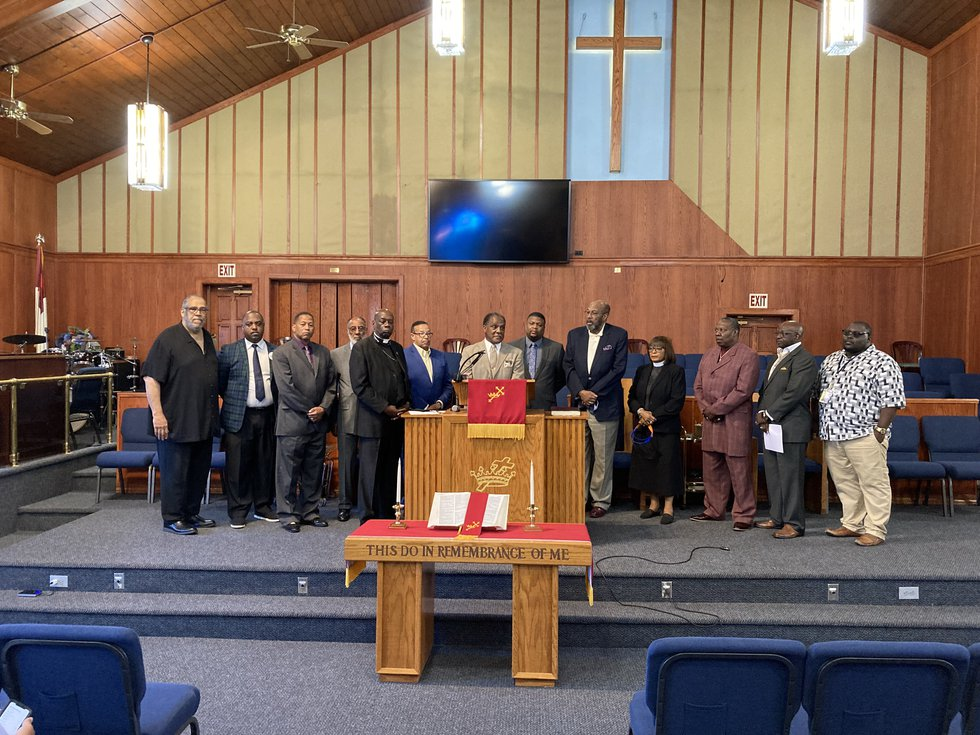 More than a dozen clergy and community leaders gather at Mt. Olive Baptist Church to denounce...