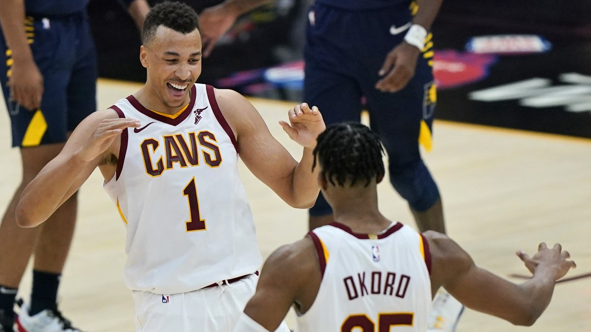 Cleveland Cavaliers' Dante Exum (1) celebrates with Isaac Okoro after Okoro scored late in the...