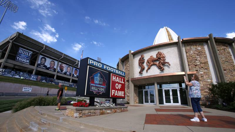 FILE - In this Aug. 7, 2015, file photo, a visitor to the Pro Football Hall of Fame pauses to...