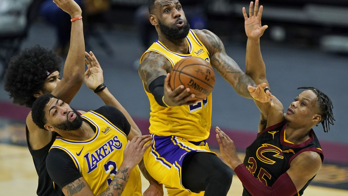 Los Angeles Lakers' LeBron James drives to the basket against Cleveland Cavaliers' Isaac Okoro,...