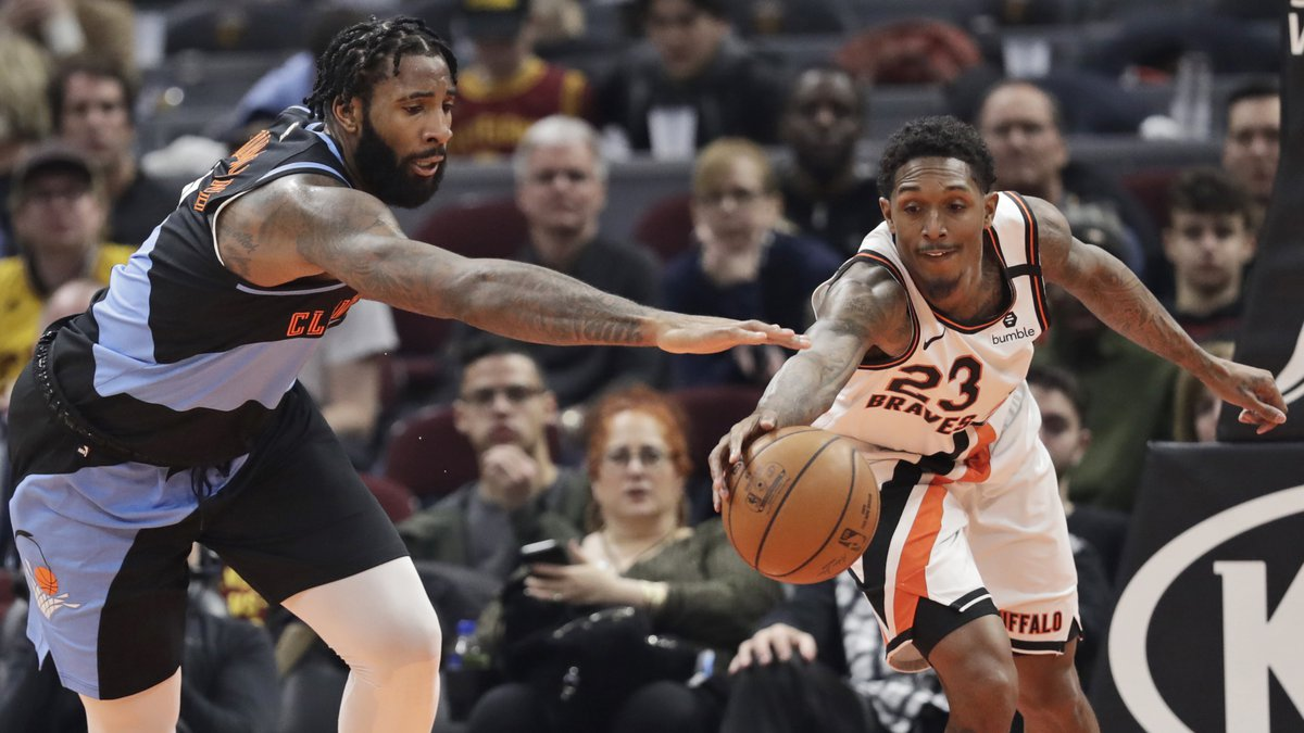 Cleveland Cavaliers' Andre Drummond, left, and Los Angeles Clippers' Lou Williams battle for...