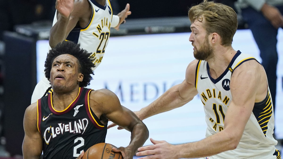 Cleveland Cavaliers' Collin Sexton (2) drives to the basket against Indiana Pacers' Domantas...