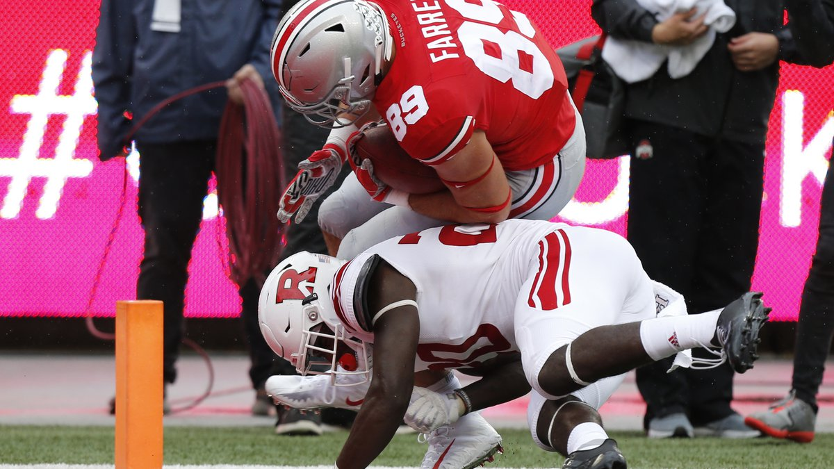 Ohio State tight end Luke Farrell, (89) scores a touchdown past Rutgers defensive back Avery...
