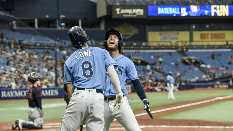 Tampa Bay Rays' Brett Phillips celebrates with Brandon Lowe (8) after Phillips hit a solo home...