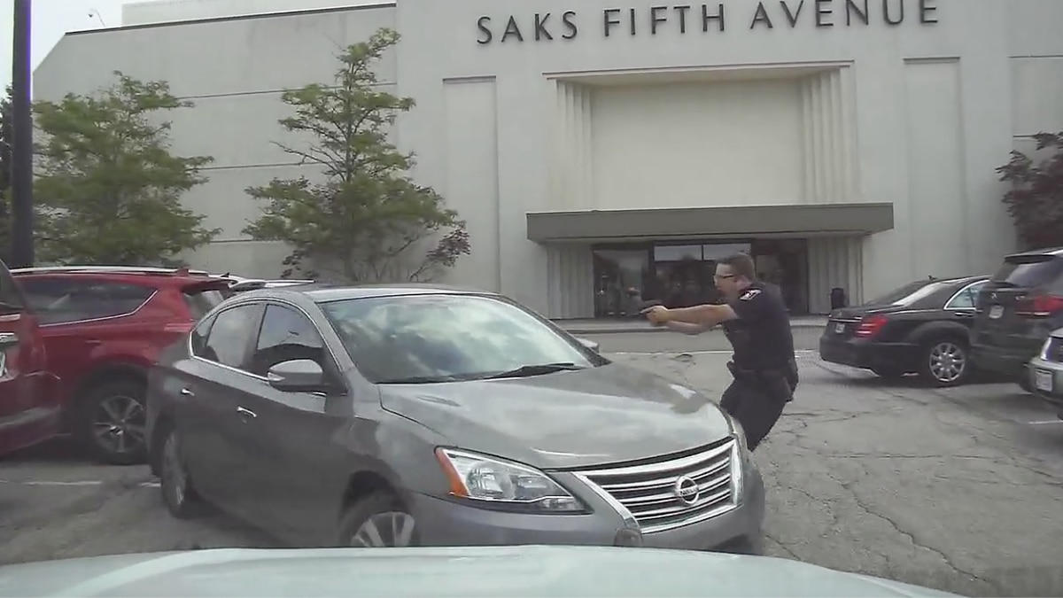 Still image from police video showing Beachwood Officer Blake Rogers pointing his gun at a...