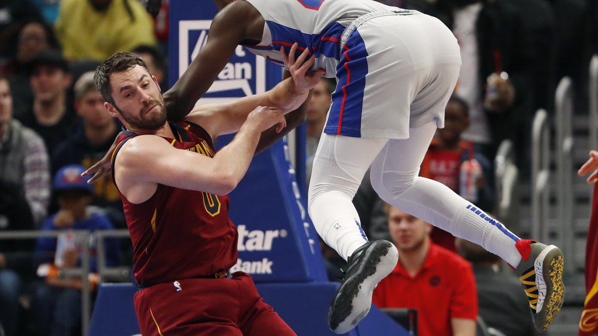 Detroit Pistons forward Sekou Doumbouya (45) falls onto Cleveland Cavaliers forward Kevin Love...