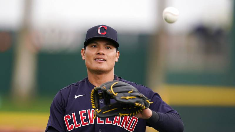 Cleveland Indians' Yu Chang, of Taiwan, warms up prior to a spring training baseball game...