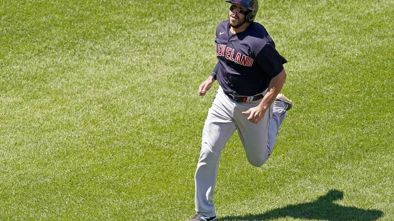 Cleveland Indians' Rene Rivera runs home to score on a single by Jordan Luplow during the fifth...