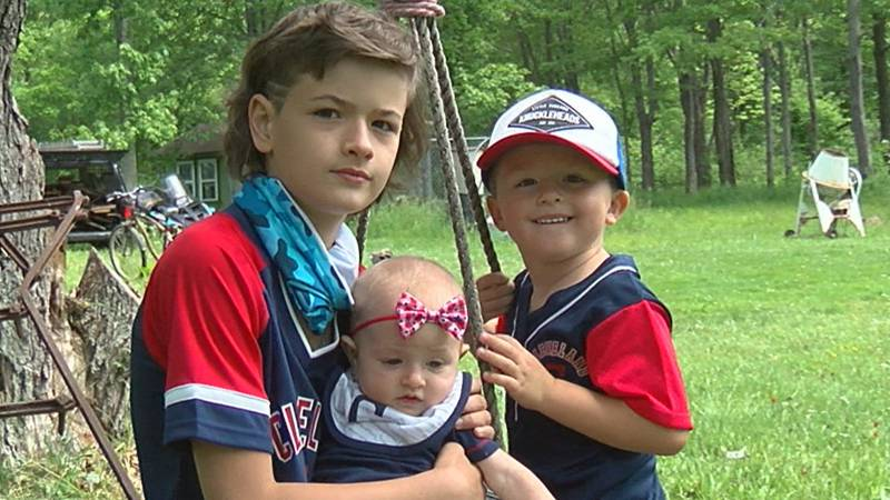 The children of fallen Army Staff Sgt. Kyle McKee post for a photo on Memorial Day.