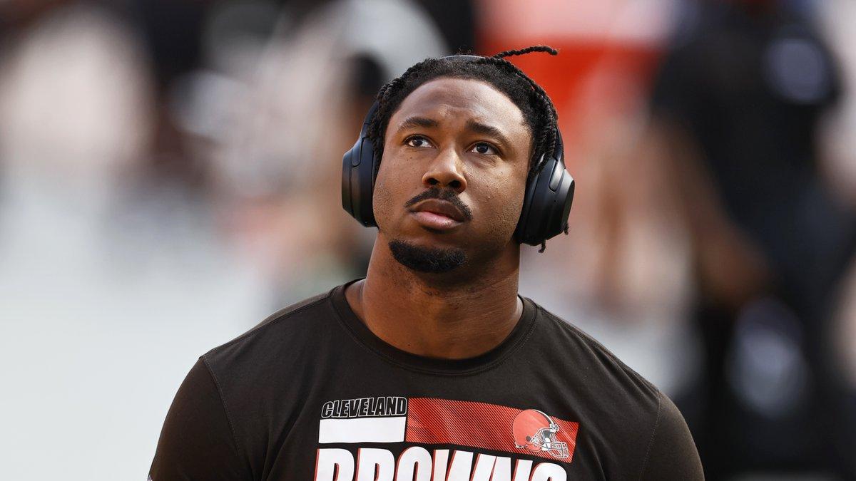 Cleveland Browns defensive end Myles Garrett walks on the field before an NFL football game...