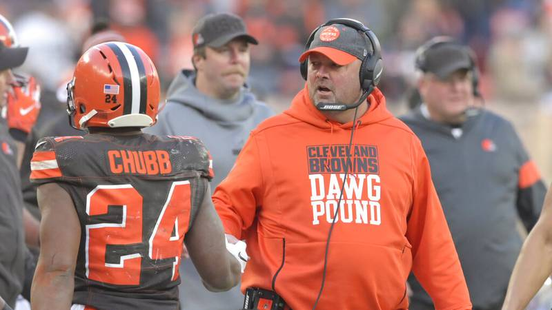 Cleveland Browns head coach Freddie Kitchens, right, congratulates running back Nick Chubb (24)...