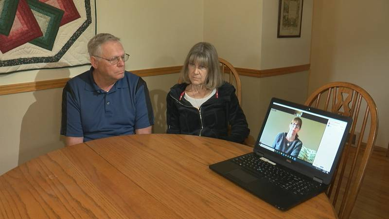Howard and Cindy Leasure look on as their daughter Patty Sacco addresses a controversial Ohio...