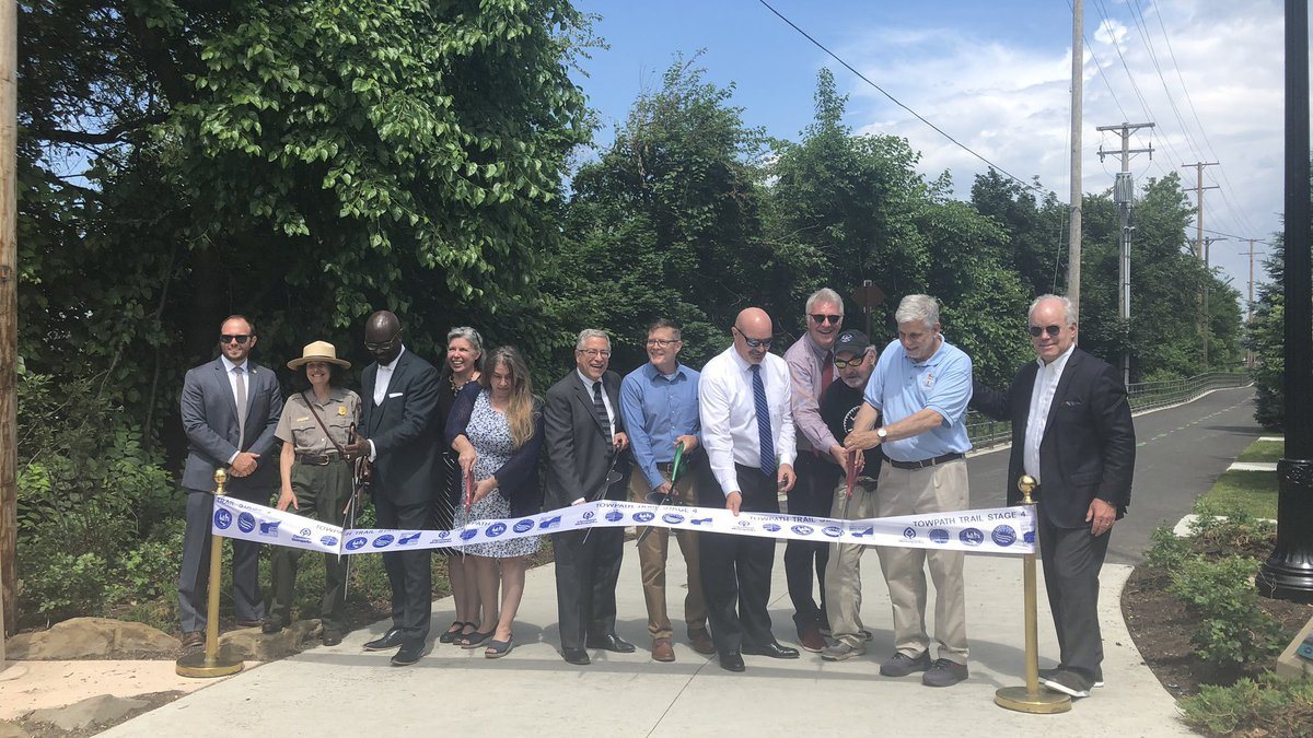 A ribbon cutting ceremony celebrates the opening of Stage 4 of the Towpath Trail