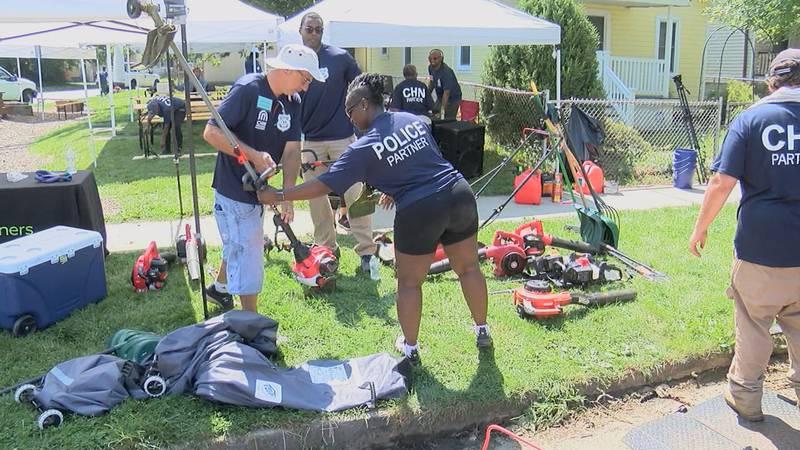Volunteers work during a neighborhood cleanup in Detroit Shoreway