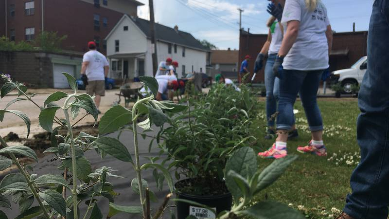 Dozens of volunteers pitched in to help revitalize parts of the Clark-Fulton Neighborhood