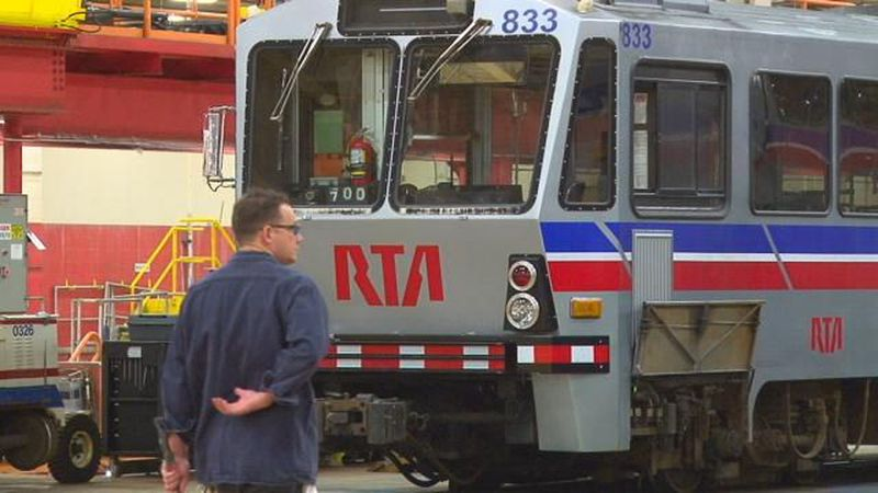 A man stands in front of an RTA train. (Source: WOIO)