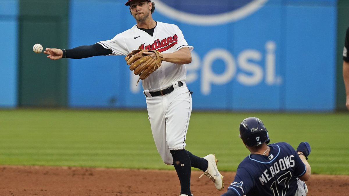 Cleveland Indians' Ernie Clement throws to first base after forcing out Tampa Bay Rays' Austin...