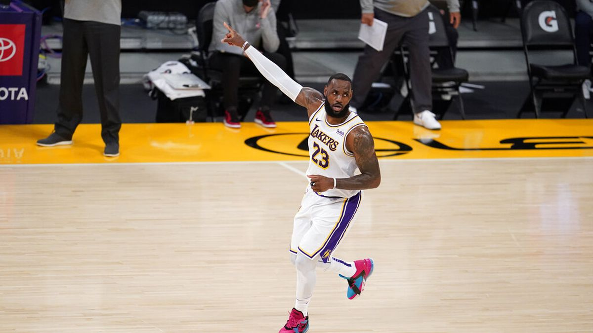 Los Angeles Lakers forward LeBron James (23) signals during the first half of an NBA basketball...
