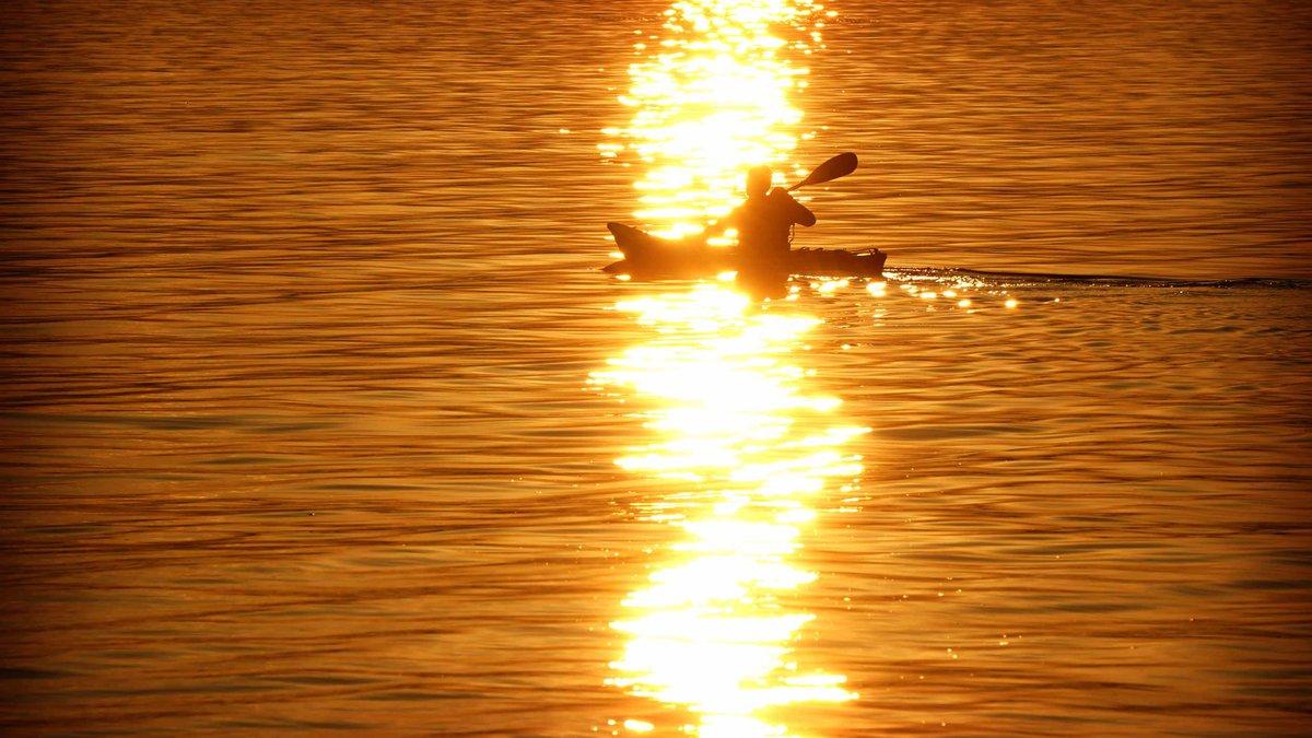 A kayak paddles past Whiskey Island on Lake Erie in December 2018.