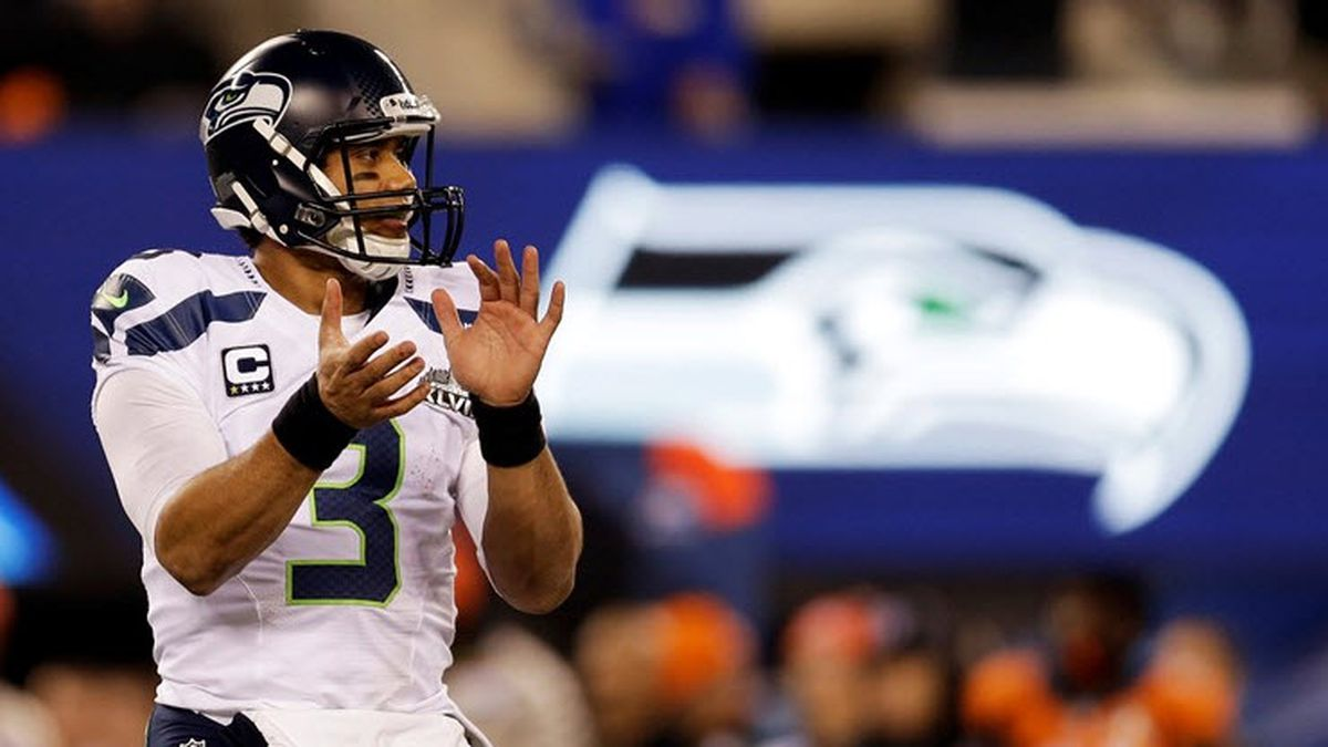 Seattle Seahawks' Russell Wilson (3) claps during the first half of the NFL Super Bowl XLVIII...