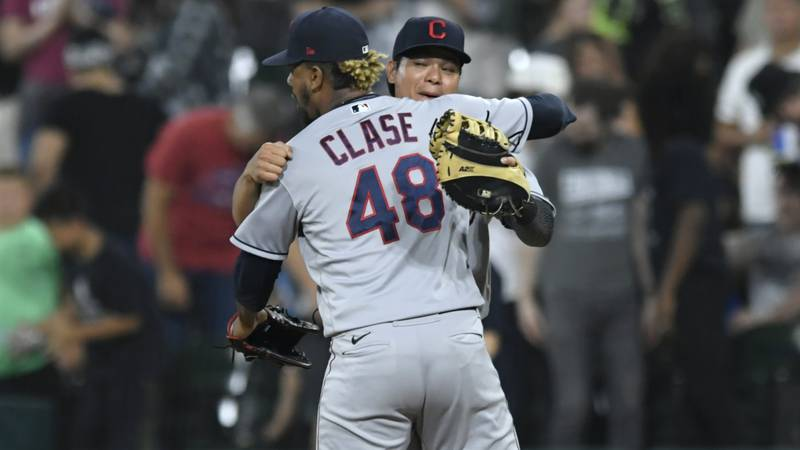 Cleveland Indians closing pitcher Emmanuel Clase (48) celebrates with first baseman Yu Chang...