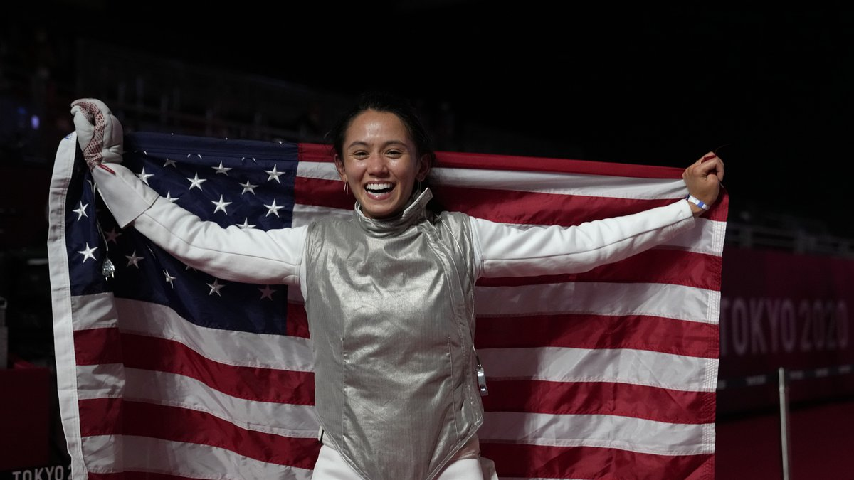 Lee Kiefer of the United States celebrates winning the women's individual Foil final...