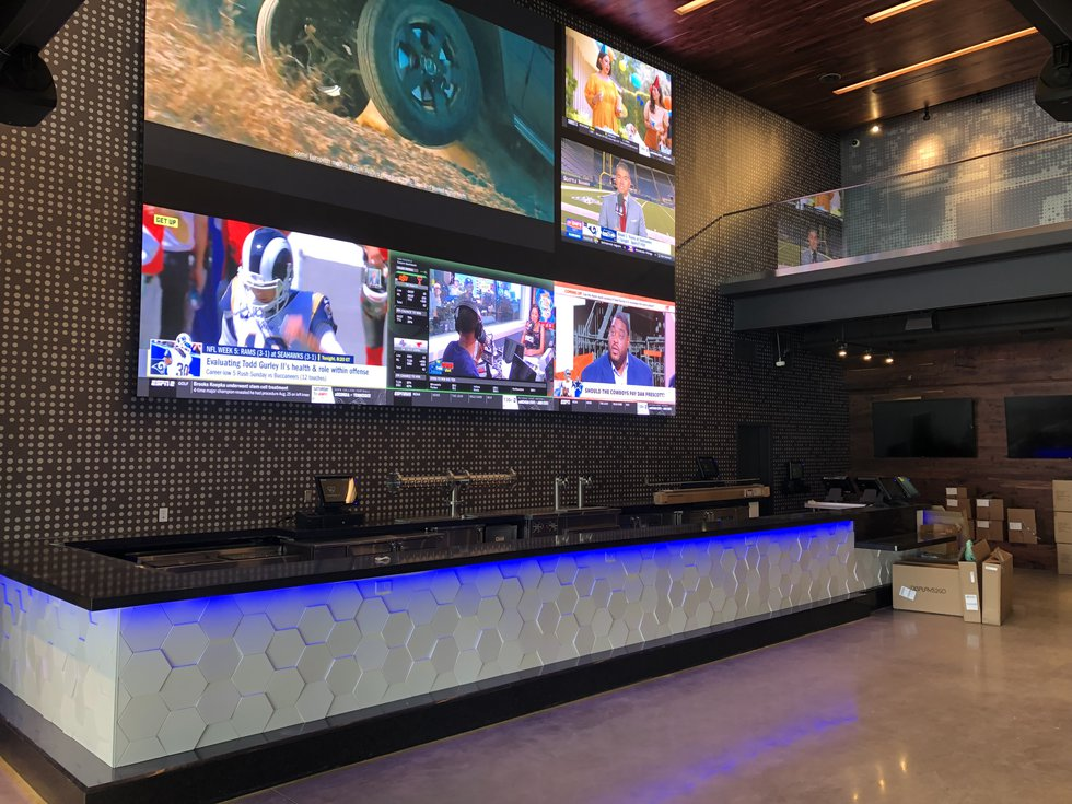 This bar are on the main floor has an 18 foot wall of televisions.