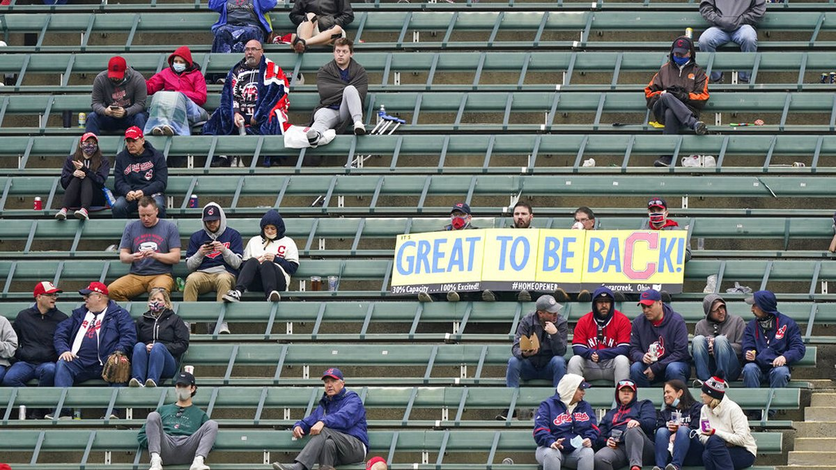 Cleveland Indians fans are glad to be back in the ballpark to watch a baseball game between the...