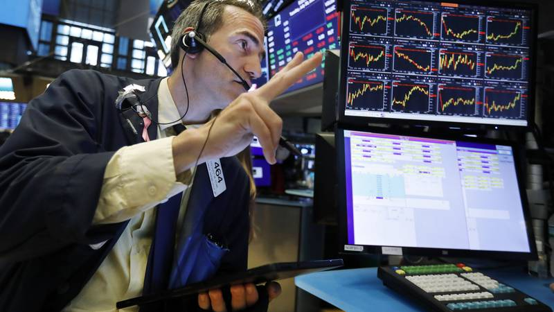 In this July 30, 2019 file photo, trader Gregory Rowe works on the floor of the New York Stock...