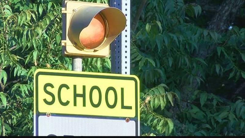 GF Default - Concerned parents prompt repair of of broken school zone lights