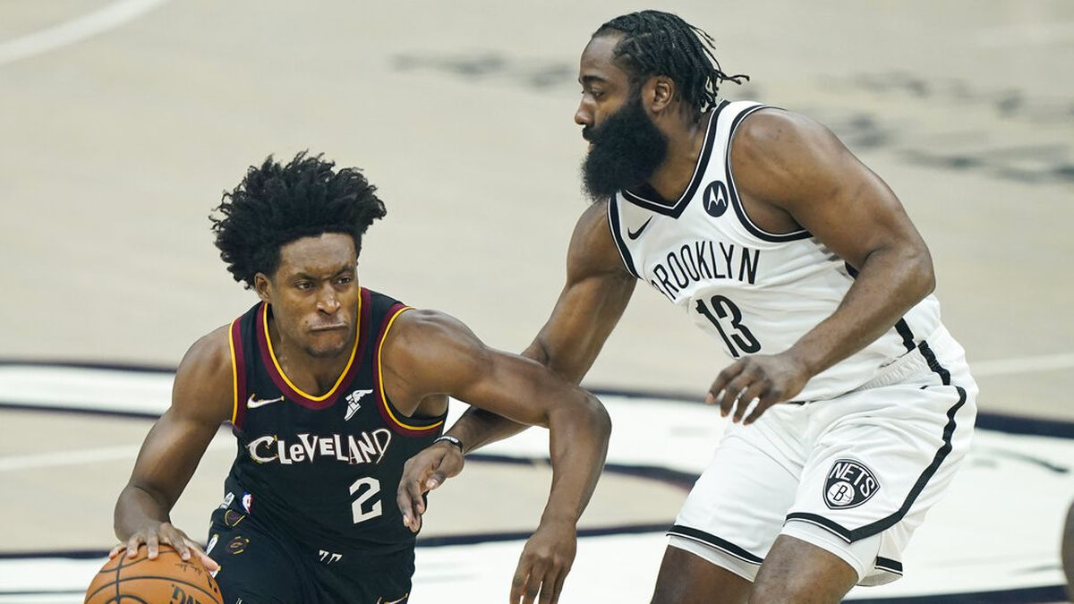 Cleveland Cavaliers' Collin Sexton (2) drives past Brooklyn Nets' James Harden (13) during the...
