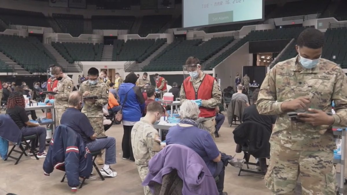 Members of the Ohio National Guard help administer COVID-19 vaccines at Cleveland State's...