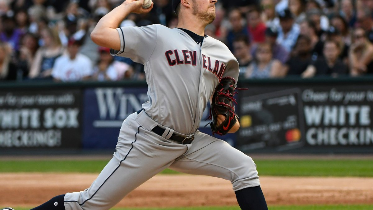 Cleveland Indians starting pitcher Trevor Bauer delivers against the Chicago White Sox during...
