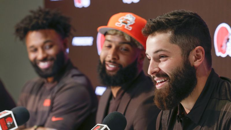 Cleveland Browns quarterback Baker Mayfield, right, answers questions during a news conference...