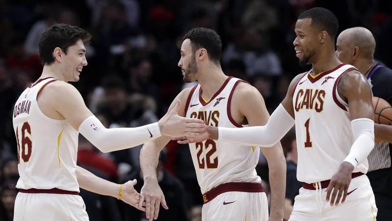Cleveland Cavaliers forward Cedi Osman, left, celebrates with forward Larry Nance Jr., center,...