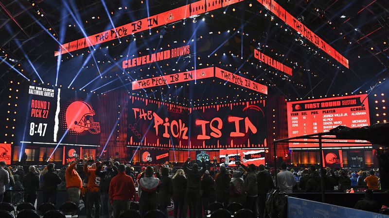 Fans gather around the stage as they wait for the Cleveland Browns to make their first-round...