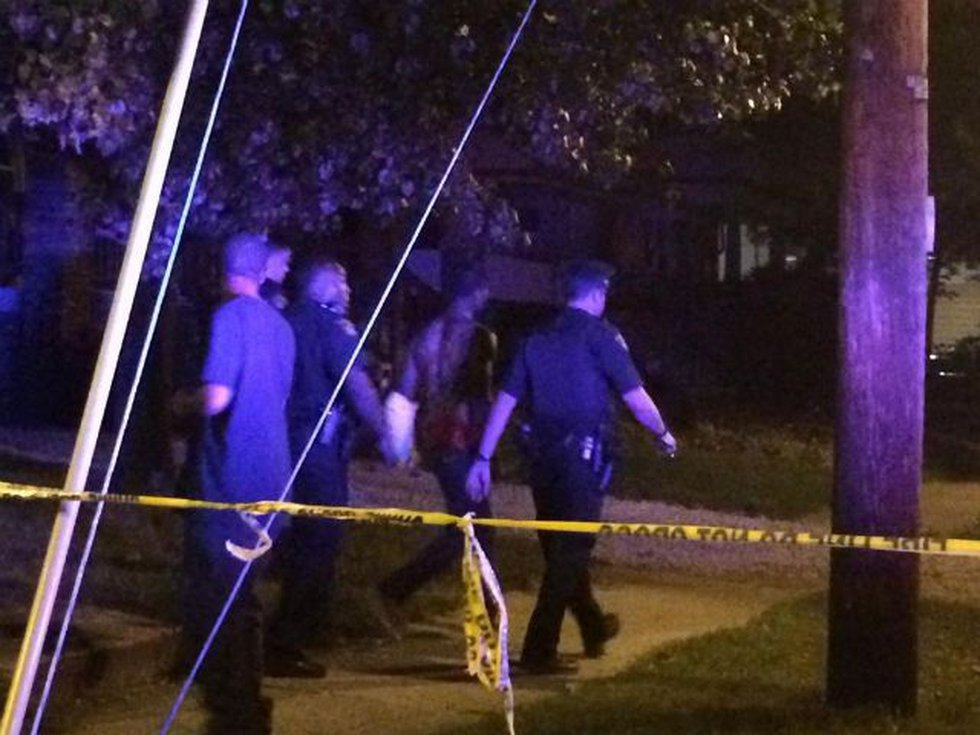 Police rope off crime scene at East 113th (Source: WOIO)