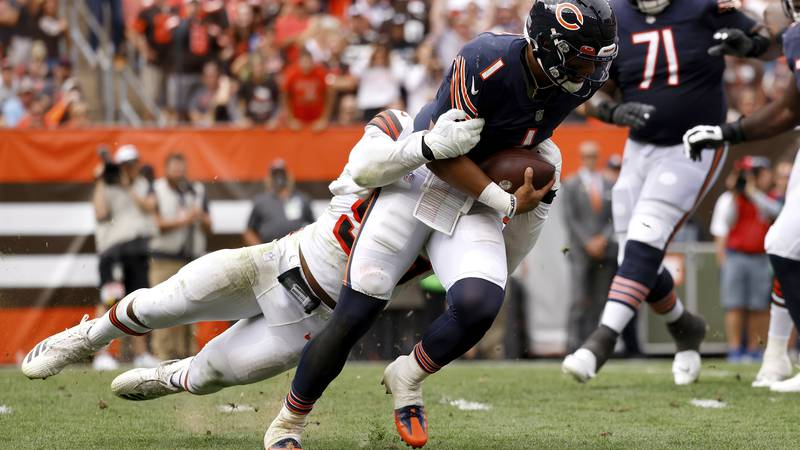 Chicago Bears quarterback Justin Fields (1) is sacked by Cleveland Browns defensive end Myles...