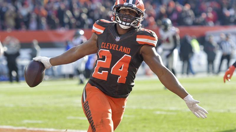 FILE - In this Nov. 11, 2018 file photo Cleveland Browns running back Nick Chubb celebrates...