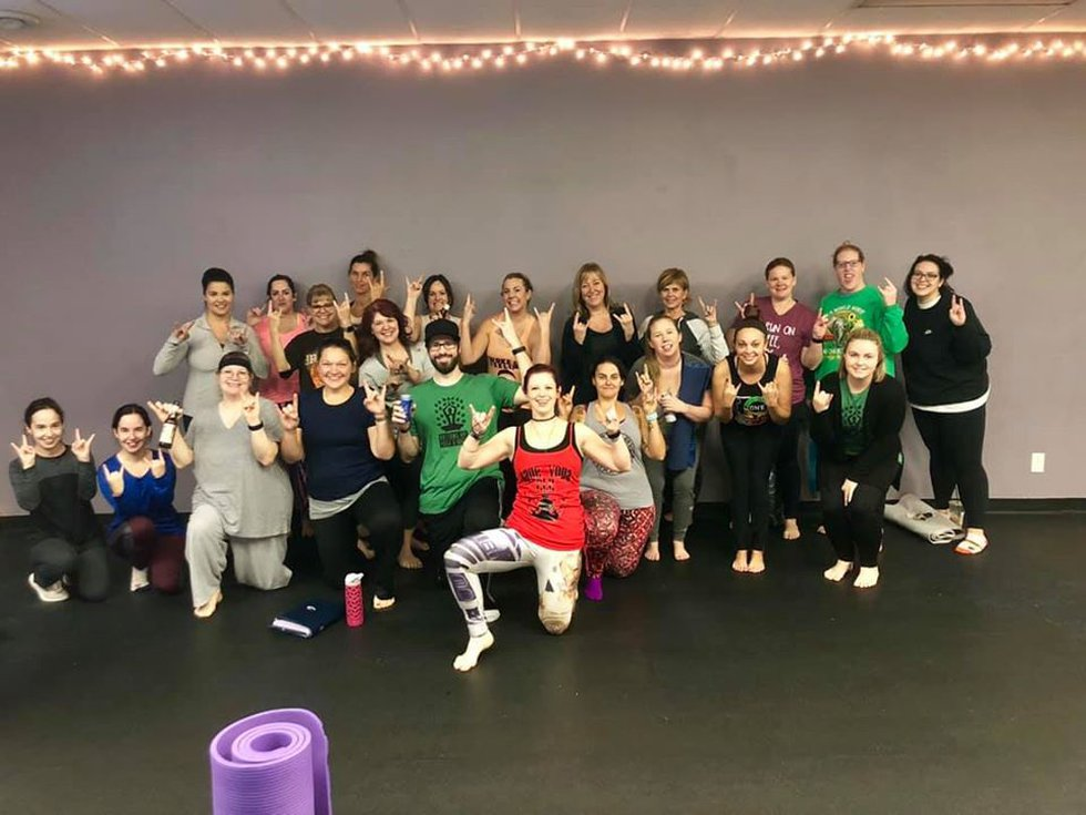 Bottoms Up! Yoga and Brew hosted a rage yoga class at River Yoga.
